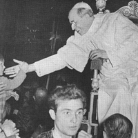 Pope Pius XII reaching out to a youngster