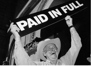 Ralph Klein celebrates retiring Alberta's provincial debt