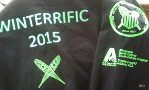 A staple of the Winteriffic Races: sharp long-sleeve shirts, no doubt designed by Colleen Millonig . . . .