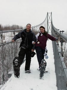 Snowshoeing across the great suspension bridge at Scenic Caves Nordic Center.