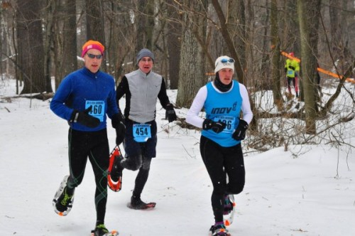 Amy Rusiecki (436), S. Deerfield, MA, wins the women's half-marathon silver shown here racing with trail friend, Erik Wight (L), Amherst, MA, who won his class silver. David Sapinski, Medford, also captured a class silver medal.