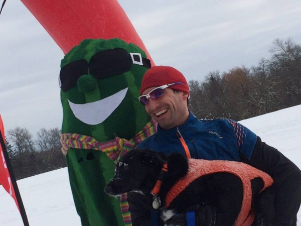 Brad Zoller with his training partner, Senna, last year in Barrington, IL for the Frozen Zucchini 5k snowshoe race. Photo courtesy of Brad Zoller.