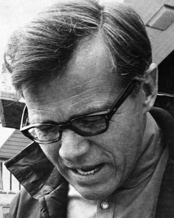 One b/w photograph of Tage Pedersen, 1960-.  He is wearing eyeglasses and looking downward.
