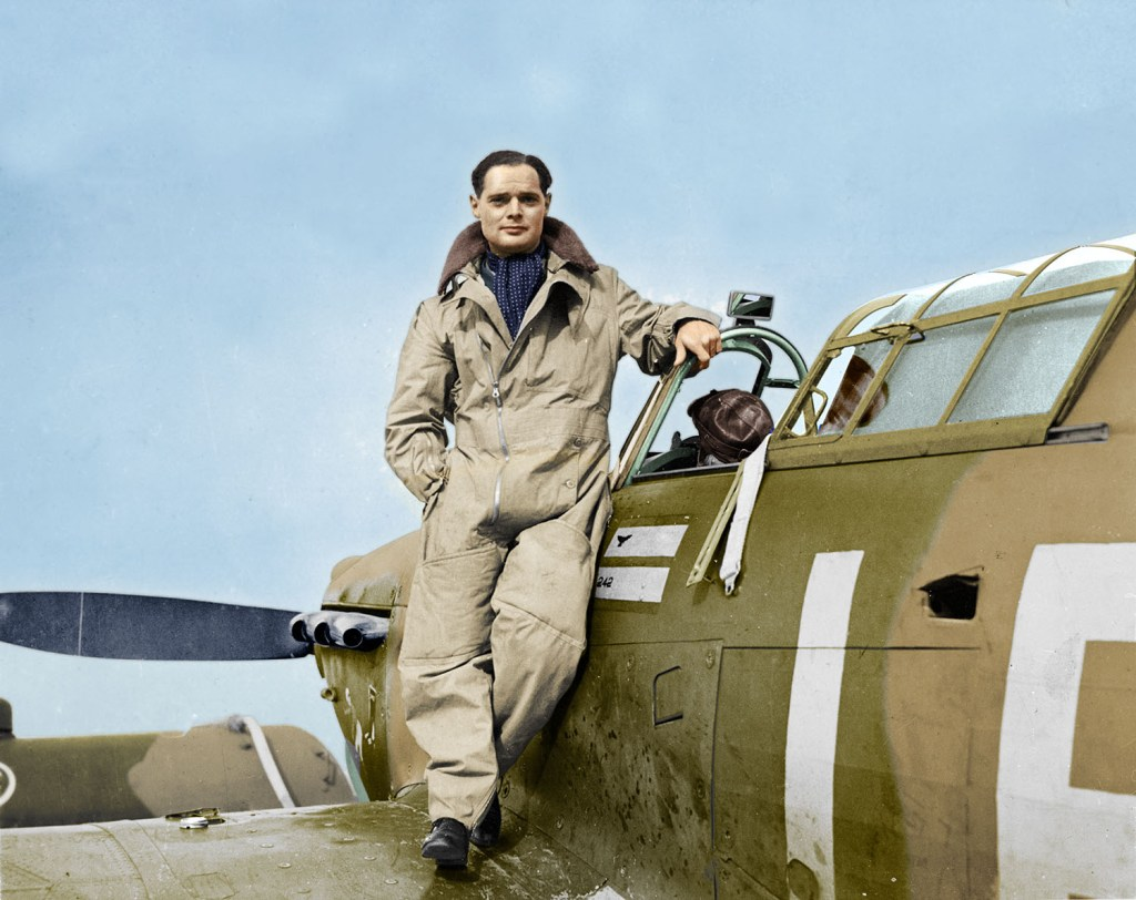 Sir Douglas Bader stands on the wing of his fighter plane