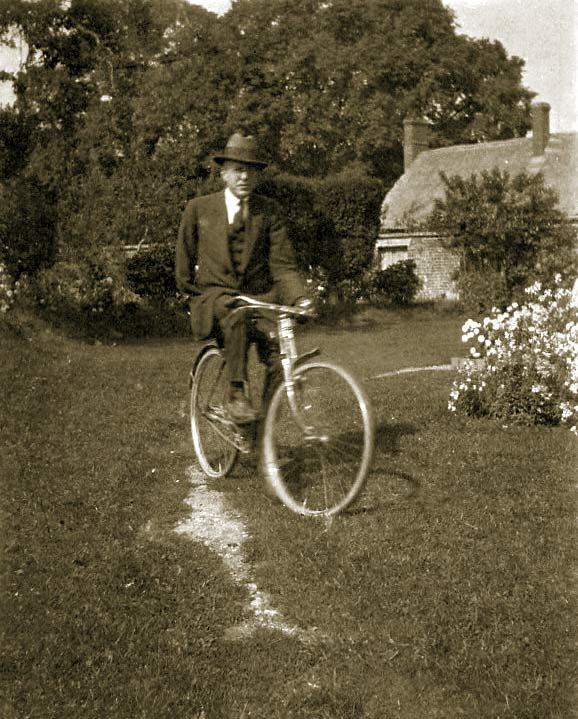 Frank Chapman riding a bicycle
