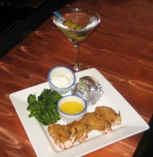 A Dirty Martini goes with the crab and Ritz-stuffed shrimp with broccoli and baked potato at the Marquee Club in Waterbury. Michele Morcey