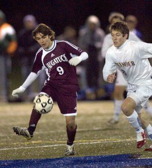 WATERBURY, CT- 29 OCTOBER 2008 --102908JS04--Naugatuck's Tiago Martins (9) clears the ball while being defended by Seymour's Matt Brown (8) during the NVL boys soccer Finals Wednesday at Municipal Stadium in Waterbury Jim Shannon / Republican-American