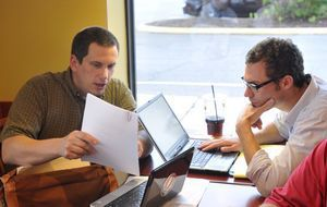 Jeff Myer, left, of Middlebury and Wil Koch of Madison talk during a meeting of computer hackers at Panera Bread in Meriden on Wednesday. Irena Pastorello/RA