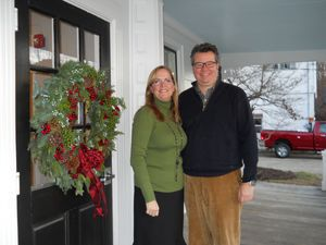 Susan Sweetapple and Colin Chambers, new owners of The Falls Village Inn, stand on its porch. The refurbished inn and restaurant opened for business Thursday. Ruth Epstein Republican-American