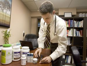 Dr. Shawn Carney of Northeast Natural Medicine prepares some natural medicine for patients in his office in Newtown Wednesday. Steven Valenti Republican-American