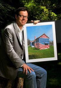 Robert Carley of Darien has traveled across the country photographing flags and flag displays for the past 10 years. He has collected more than 33,000 images in 43 states as part of his project.   Jim Shannon/Republican-American