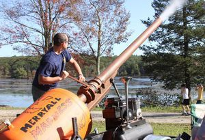 Kevin Sullivan of Washington, Conn., fires his pumpkin cannon during the Warren Fall Festival on Saturday. The cannon was shooting small pumpkins nearly across the pond at Warren Woods. John McKenna Photo