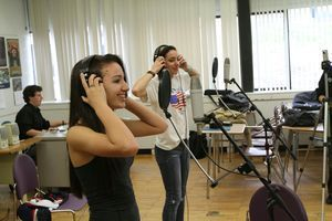 Torrington High School sophomores Jordyn Fenwick, left, and Felice Magistrali record Wednesday in a music studio improvised by Music in Common in a high-school classroom. A local students have collaborated to write and perform original music, and will take the stage Friday. Jim Moore Republican-American.