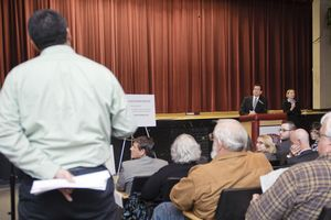 Gov. Dannel Malloy listens to a question from the audience Thursday night in the auditorium at Torrington High School. It was the latest stop on Malloy's education reform tour. Teachers, parents and administrators filled the room. Erin Covey Republican-American.