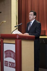 Gov. Dannel P. Malloy answers a question Thursday night in the auditorium at Torrington High School. It was the latest stop on Malloy's education reform tour. The meeting brought out a near full house with teachers, parents and administrators. Erin Covey / Republican-American.