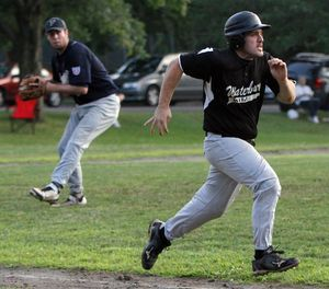 WATERBURY, CT- 10JULY072412MK12 Waterbury Wild's John Diglovanni runs to first as Fedell's pitcher throws him out at first base during their opening round against Fedell in the Stan Musial state tournament Tuesday evening at Waterville park in Waterbury. Michael Kabelka / Republican-American