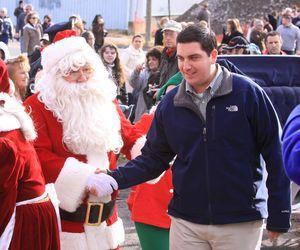 Torrington Mayor Ryan J. Bingham greets Santa upon his arrival at Christmas Village on Sunday. John McKenna/RA