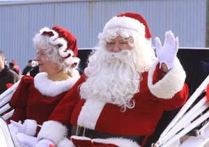 Santa and Mrs. Claus arrive at Torrington's Christmas Village on a horse-drawn wagon on Sunday. John McKenna/RA