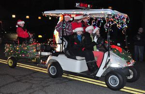 Samantha and Katherine Starr, daughters of Ane and Matt Starr, piloted a golf cart with their friend Claire Lee in the Parade of Lights on Saturday evening. Matt Starr is the chief of the Kent Volunteer Fire Department. His son, Will, is in the trailer behind the cart.