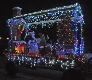 Santa came to town Saturday evening in his own house-shaped float covered with lights, complete with a chimney. The Kent Volunteer Fire Department sponsored the Parade of Lights on Main Street. Lynn Mellis Worthington Republican-American