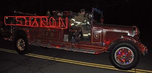 SHARON'S ANTIQUE APPARATUS WAS ONE OF THE MANY LIGHTED TRUCKS THAT PARTICIPATED IN THE SECOND ANNUAL PARADE OF LIGHTS ON MAIN STREET IN KENT ON SATURDAY, SPONSORED BY THE KENT VOLUNTEER FIRE DEPARTMENT. Lynn Mellis Worthington / Republican-American