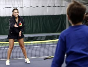 Maria Biondi, 17, a member of the Newtown High School tennis team, practices tennis drills with Evan Wologodzew, 10, of Newtown during a fundraiser Sunday at the Middlebury Racquet Club in Middlebury. The event raised money for the Sandy Hook Support Fund. Christopher Massa/RA