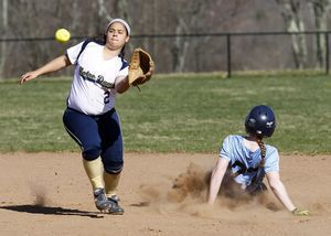 Oxford, CT- 25 April 2013-042513CM06- Oxford's Meg Sastrum slides safely into second as Notre Dame's Becky Stefanatos can't receive the ball in time during SWC softball action Thursday afternoon in Oxford. Christopher Massa Republican-American