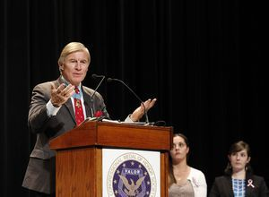 Paul W. Bucha, a Vietnam War veteran and recipient of the Congressional Medal of Honor, addresses audience members during a ceremony at Newtown High School on Monday afternoon. Family members representing the six adult victims of the Sandy Hook Elementary School shootings received citizen honor medals honoring their loved ones posthumously.  The medals were bestowed by Medal of Honor recipients during the ceremony. Christopher Massa/RA