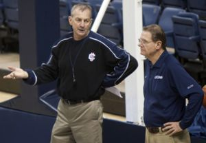 Connecticut head coach Jim Calhoun, left, speaks to associate head coach George Blaney, right, during his first practice back with the team in Storrs, Conn., on Friday, Feb. 12, 2010. Blaney took over Calhoun's coaching duties for three weeks while Calhoun took a medical leave of absence. (AP Photo/Thomas Cain)