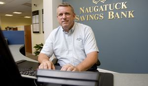 Robert Voets works on a computer at Naugatuck Savings Bank in Naugatuck, where he helps customers with computer fraud and security issues in Naugatuck Thursday. Voets is a former West Haven cop and now works for he bank. Steven Valenti Republican-American