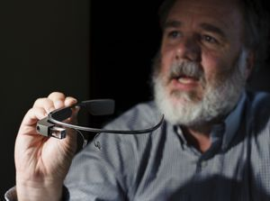 Aldon Hynes talks about his Google Glass device. Erin Covey/RA