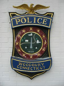 The police shield outside the Resident State Trooper's Office in Woodbury. RA Archive