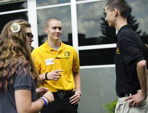 Cody Murphy, a senior wearing a yellow shirt, talks to two incoming freshman Wednesday at Oliver Wolcott Technical High School. Anastasia Lazzaro (L) and Joshua McCue (R) are among the ninth-graders who have been assigned to Murphy, who applied to be a mentor. The new program is to help freshmen navigate classes and easily get information from the school's veteran students. Erin Covey Republican-American.