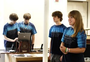 Becca DiSarro, 17, answers a question during a robotics demonstration at the Woodbury Public Library Saturday afternoon. Standing next to her is Phil Michener, 15. With them are team members, Alex Williams, 16, left and Braeden Mathieson, 14. The group are members of Nonnewaug High School's Team Beta, a robotics team. Christopher Massa Republican-American