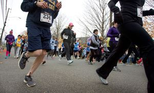 Runners start the sixth annual Pilgrim's Pace 5K, sponsored by the Middlebury Congregational Church, in Middlebury Saturday.  Steven Valenti Republican-American