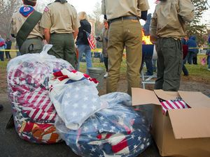 Nearly 4,000 retired flags wait to be placed into the fire on Sunday as part of a flag retirement ceremony organized by Joseph Guinazzo.