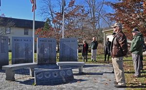 Don DeVita listens as the Rev. Lee Hellwig says a prayer during the Veterans Day ceremony Monday morning at the Veterans Memorial in Kent. Veterans performed a 21-gun salute and a few words were shared to remember those who have served the country in the armed services. Lynn Mellis Worthington/RA