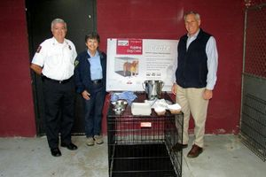 Southbury officials, from left, Barry Rickert, fire marshal and emergency management director; Marilyn Muratori-Jarvis, animal control officer; and First Selectman Ed Edelson with a pet crate acquired by the town for use during storm emergencies. Contributed
