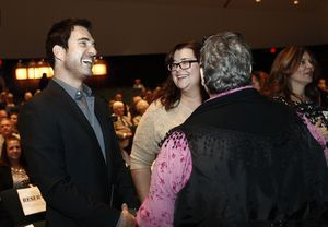 Actor and Waterbury native Dylan McDermott, left, shares a laugh with sister Robin McDermott-Herrera of Essex, center and Anita Bologna, co-chair of the Hall of Fame Committee during an induction ceremony at Holy Cross High School in Waterbury Saturday afternoon. McDermott was one of the five honorees inducted into the Silas Bronson Library's Waterbury Hall of Fame. . Christopher Massa Republican-American