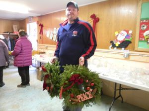 Brian Pedersen of Sharon finds the perfect wreaths at the Sharon United Methodist Church Holiday Fair Saturday. Ruth Epstein Republican-American