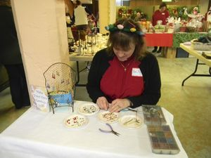 Creating earrings at the Sharon United Methodist Church Holiday Fair Saturday is its pastor, the Rev. Peggy Laemmel. Ruth Epstein Republican-American