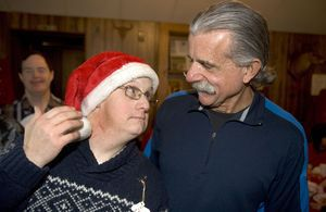 From left, Edward Roland of Wolcott shows off his Santa hat while thanking Greg Gubitos of the Wolcott Land Owners Association for the Christmas party in Wolcott Saturday. The Wolcott Landowners Protective Association held its annual Christmas party for residents with special needs.  Steven Valenti Republican-American