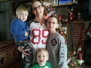 Danielle Dubois stands with her three sons, from left, Spencer, 1, Sean, 5, and Aydyn, 10. Dubois recently got a phone call from Wal-Mart that someone anonymously paid off a Christmas present she had on layaway at Wal-Mart. Bruno Matarazzo Jr. Republican-American