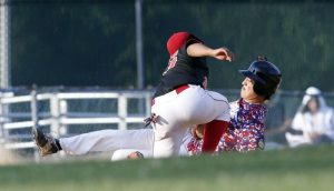 Waterbury, CT- 30 June 2015-063015CM11- Waterbury's Justen Rodriguez tags out Oakvilles Grant Wallace as he attempts to pick up an extra base at third, during their American Legion baseball matchup at Municipal Stadium in Waterbury on Tuesday. Waterbury won, 1-0. Christopher Massa Republican-American