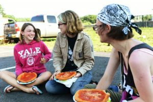 TORRINGTON, CT - 16 July 2015-071615EC03-- Ashley Buick and her sisters, Sarah and Annabel, enjoy fried dough Thursday night at the weekly event in Torrington, The Marketplace. Erin Covey Republican-American.