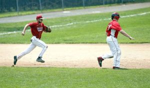 Bristol, CT- 19 July 2015-071915CM04- Wolcott's Phil Olmstead, right, is caught in a run down with Bristol's Jaeden Rasmus during their American Legion matchup at Muzzy Field on Sunday. Olmstead would be tagged out as Wolcott would go onto lose, 5-0. Christopher Massa Republican-American