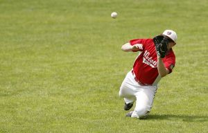 Bristol, CT- 19 July 2015-071915CM03- Wolcott right fielder, Phil Olmstead makes a diving catch during their American Legion matchup against Bristol at Muzzy Field on Sunday. Wolcott would go onto lose, 5-0. Christopher Massa Republican-American