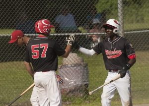 WATERBURY, CT--- -072215JS06-- Waterbury's Tyriq Harris (5) is congratulated by teammate Matt Mancini (57) after coming in to score during their American Legion tournament game against Greenwich Wednesday at Bucks Hill Park in Waterbury.   Jim Shannon Republican-American