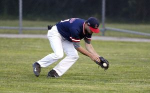 Torrington, CT- 20 August 2015-082015CM07- Litchfield Cowboys' Dylan Clark scoops up a grounder against Tri-Town during the finals of the Tri-State League championship at Fussenich Park in Torrington on Thursday. Christopher Massa Republican-American