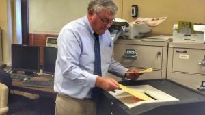 Election moderator Patrick Maloney feeds ballots from Waterbury's 2nd District Republican primary into a tabulator during a recount on Friday. The results of Wednesday's vote, which was decided by a margin of six ballots, remained unchanged. Penelope Overton Republican-American